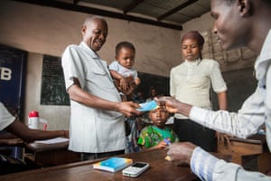 Pastor Thierry Kasiala goes with his family to a vaccination centre in the zone of Mfumu Nkento