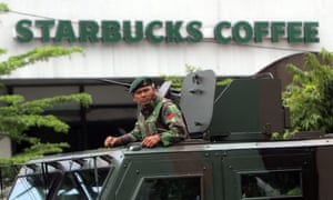 An Indonesian soldier on guard in an armoured vehicle after a bomb blast in front of a shopping mall in Jakarta on Thursday.
