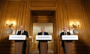 Boris Johnson speaks while Chris Whitty, U.K. chief medical officer, left, and Patrick Vallance, U.K. lead science adviser, listen during a coronavirus news conference inside 10 Downing Street in London