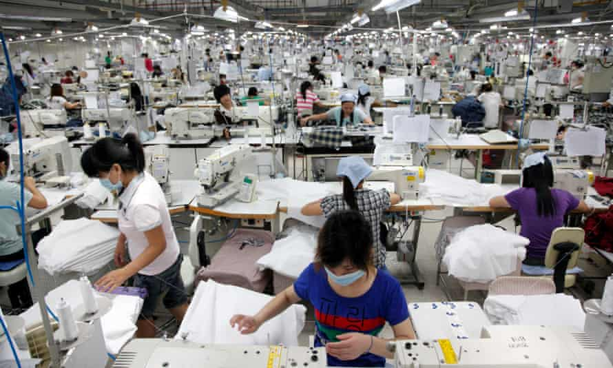 Women working in a textile factory in Guangdong province, China
