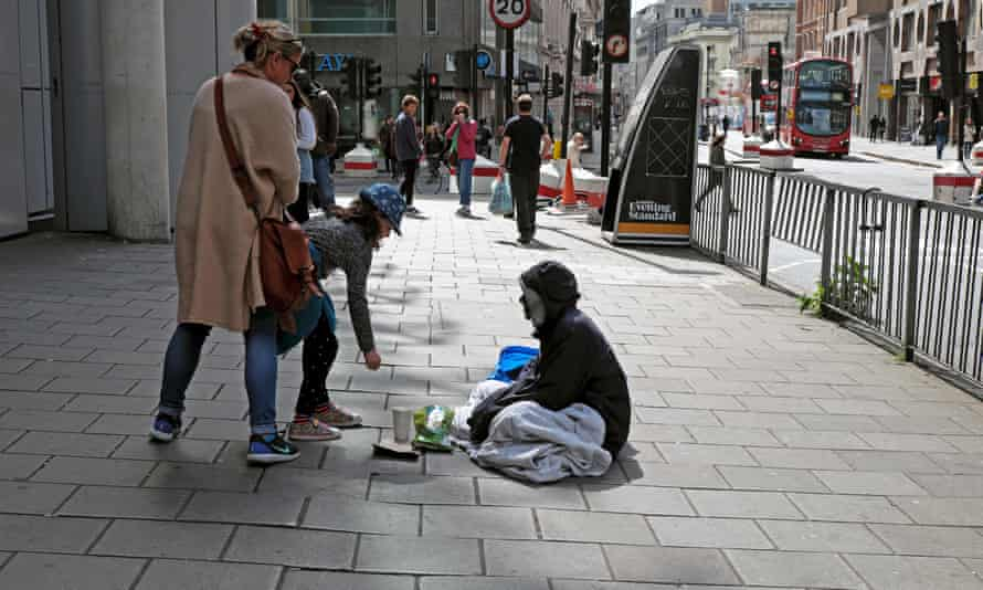 Girl giving money to a homeless woman