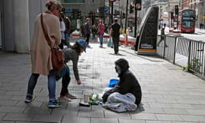 Girl gives homeless person money