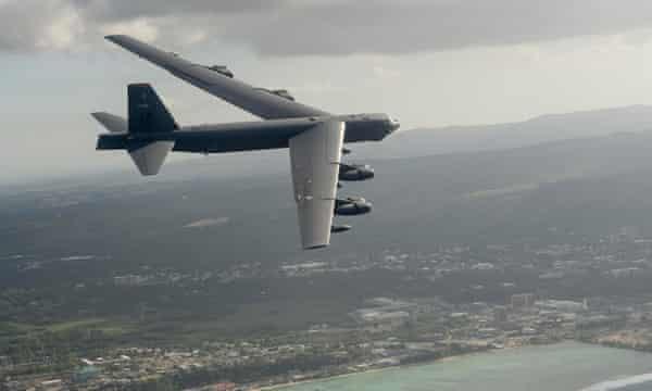 A US B-52H Stratofortress strategic bomber flies off the coast of Guam.