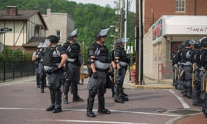Riot police block the streets in Pikeville
