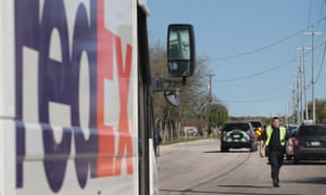 A police officer blocks a road outside a FedEx facility following an explosion Tuesday in Schertz, Texas.