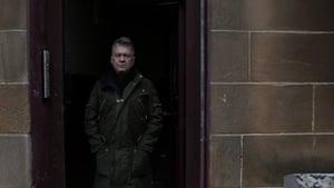 Jimmy Barnes in a doorway in Glasgow