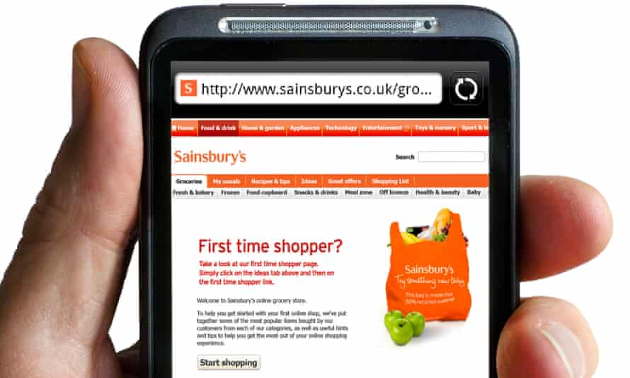 Someone looks at Sainsbury's online store on a phone
