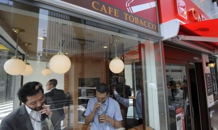 Businessmen at a 'Cafe Tobacco' shop in Tokyo's Shinbashi district