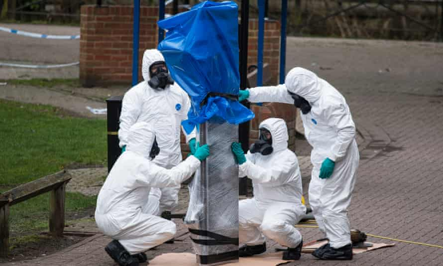 Army Officers remove the bench where Sergei Skripal and his daughter were found, in Salisbury