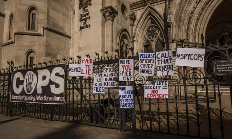 Signs put up outside the Royal Courts of Justice in London in March 2019 by victims of police undercover operations