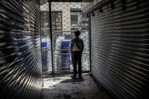 Istanbul, Turkey: a man stands next to shuttered shops on Istiklal Street, closed by the police for a weekly vigil for Turkish people who 'disappeared' while in the custody of state-linked agencies and paramilitary groups
