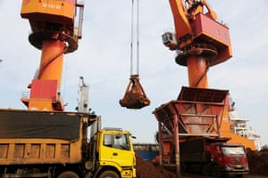 Imported iron ore being unloaded at a port in Lianyungang, Jiangsu Province of China.
