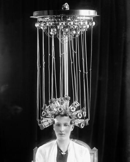 A woman models the latest permed hairstyle for hairdresser company Eugène Ltd in 1923.