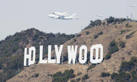 Trouble overhead … aircraft pass the Hollywood sign.