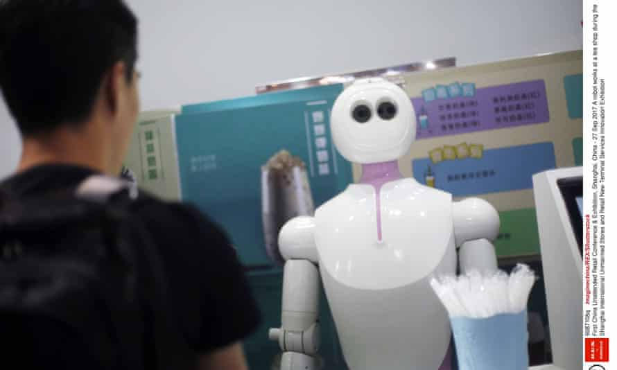 A robot works at a tea shop during a Shanghai conference. Photo by Imaginechina/REX/Shutterstock (9087108q)