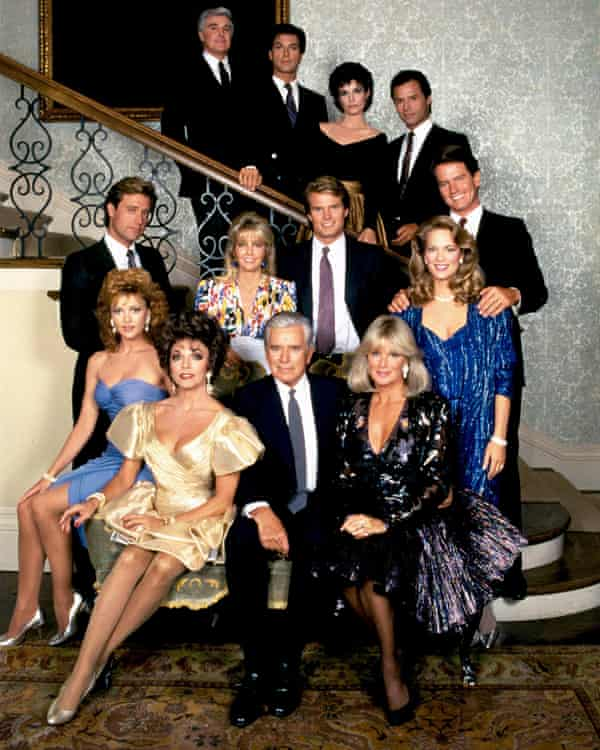Michael Nader, back row, right, with the cast of Dynasty in 1981; the show's sensational storylines helped it overtake the rival soap Dallas in the ratings.