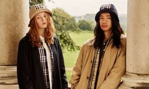 Models wearing Burberry trenchcoats