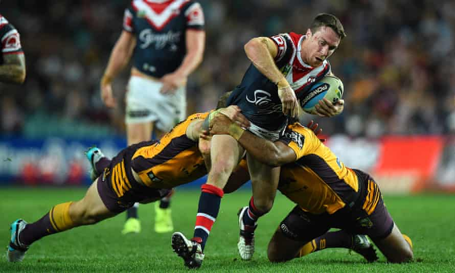 James Maloney is tackled by Jarrod Wallace and Sam Thaiday during the match between the Sydney Roosters and the Brisbane Broncos at Allianz Stadium on Saturday.