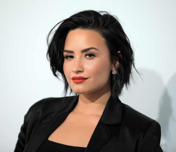 Demi Lovato, whose recent overdose was joked about by rival fans.