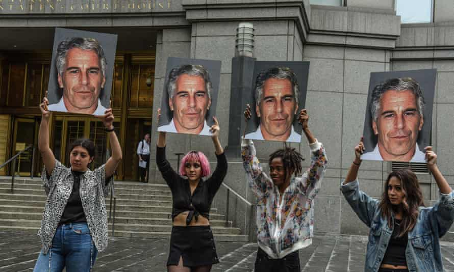 A protest group hold up signs of Jeffrey Epstein in front of the federal courthouse on 8 July 2019 in New York City.