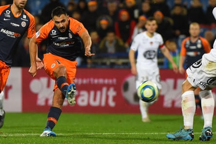 Montpellier's French forward Gaetan Laborde (centre) scores in teh 4-0 win over Brest.