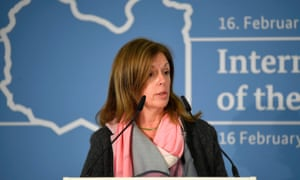 Williams at press conference in front of map of Libya