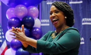 Democratic candidate Ayanna Pressley takes the stage after winning the Democratic primary in Boston, Massachusetts.