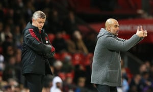 Pep Guardiola shows his appreciation for his players' efforts while Ole Gunnar Solskjær watches on glumly.