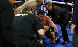 The bloodied Anthony Crolla receives attention after being knocked out by Vasiliy Lomachenko.