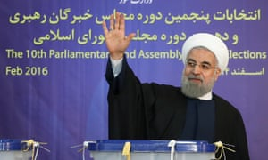 Iranian president, Hassan Rouhani, waves after casting his ballot in Tehran, Iran.