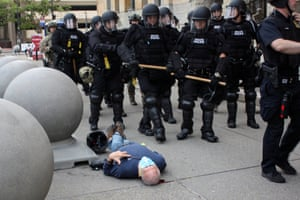 Martin Gugino lies prone after he was shoved by two Buffalo police officers during a protest against the death of George Floyd.