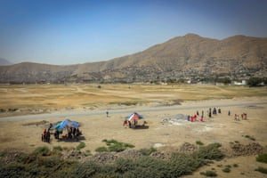 Kabul, Afghanistan: Children ride a carousel during the holy holiday