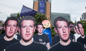 Cardboard cutouts of Facebook CEO Mark Zuckerberg during a protest over fake accounts outside the European commission in Brussels in May 2018.