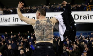 A Millwall fan displays his affections for The Den.