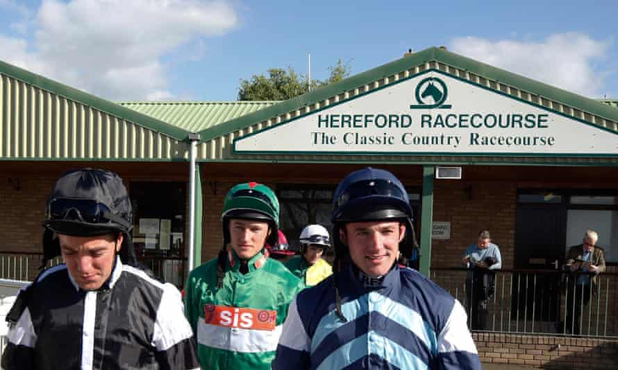 The jockeys leave the weighing room for the first race at Hereford.