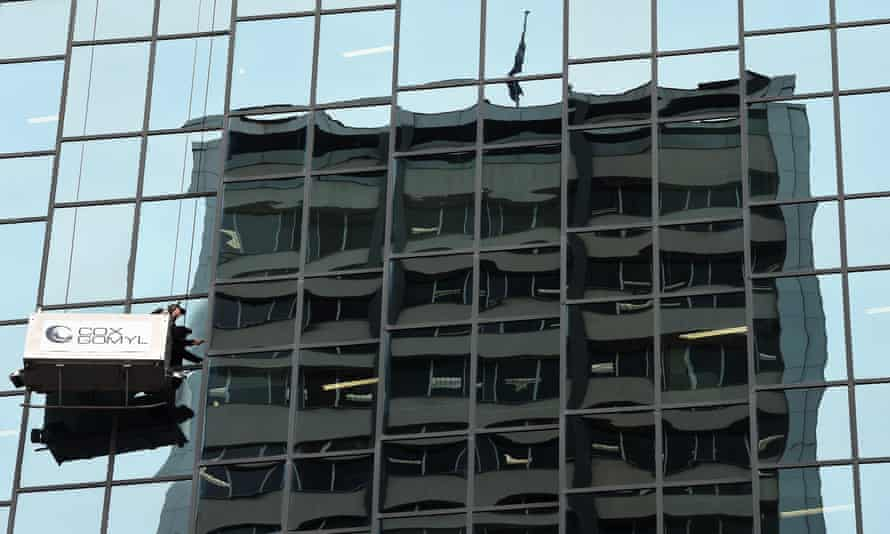 A window cleaner at work in Sydney on Thursday.