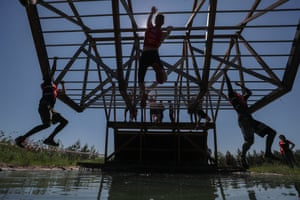 Men compete in a Hero Race extreme cross-country obstacle course event in Kazan, Russia