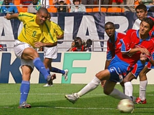 Ronaldo scores the second goal for Brazil against Costa Rica during their Group C match.