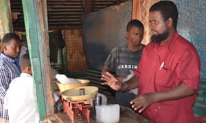 Warsame Abdihakim serving customers at his ice shop