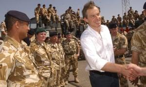Tony Blair meets British troops near Basra in 2003.