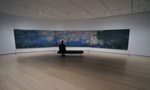 A man looks at Claude Monet's Water Lilies as the Museum of Modern Art reopens to the public on 27 August.