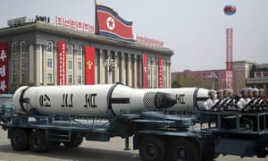 A submarine missile is paraded across Kim Il Sung Square in Pyongyang.