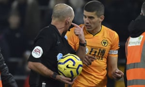 Wolves captain Conor Coady remonstrates with referee Mike Dean at half-time after Willy Boly's goal was ruled out after a VAR check.