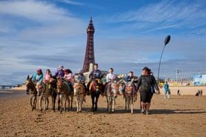 Donkeys parade on the beach