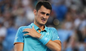 Bernard Tomic grimaces during his first round defeat to Marin Cilic at the Australian Open.