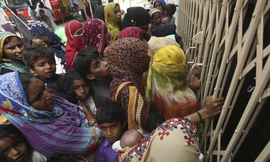Pakistani villagers wait outside a hospital to be screened for HIV in the southern province of Sindh.