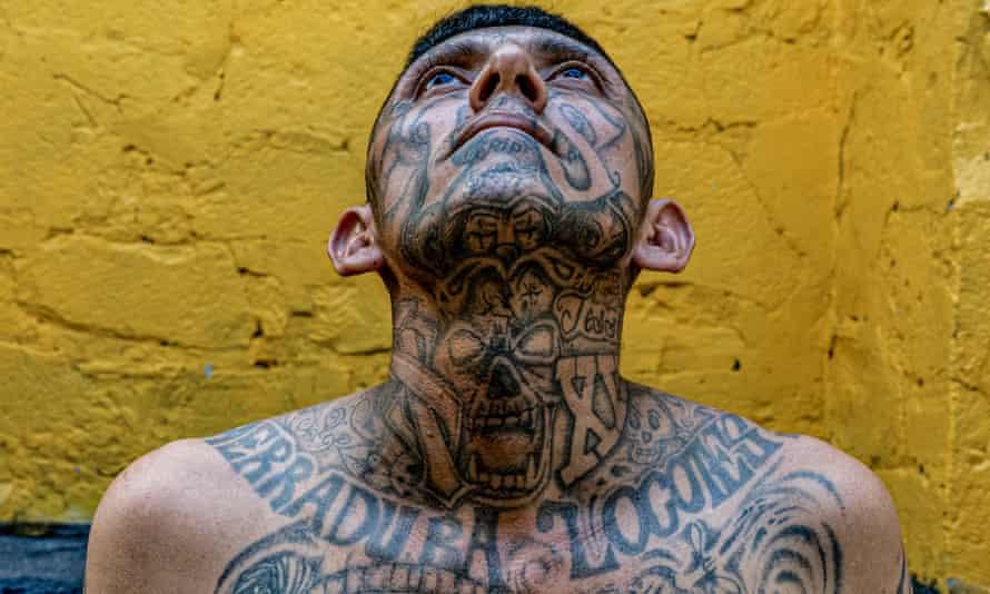 Elias (35), a member of La 18, stands for a portrait at the Penal San Francisco Gótera, El Salvador.
