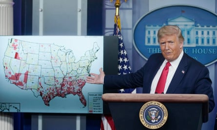 Trump gestures towards a map of coronavirus cases during a briefing at the White House on Thursday.