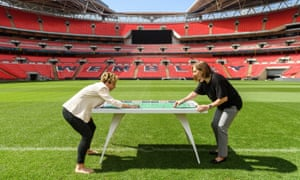 The FA's Marzena Bogdanowicz, right, at Wembley Stadium playing with the first all-female Subbuteo set.
