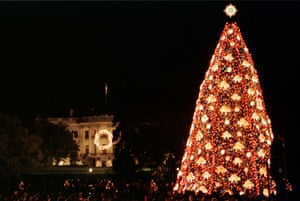 1999 - With the White House in the background, the National Christmas tree is lit on the Ellipse in Washington